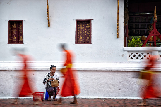 Monks receiving alms in Luang Prabang